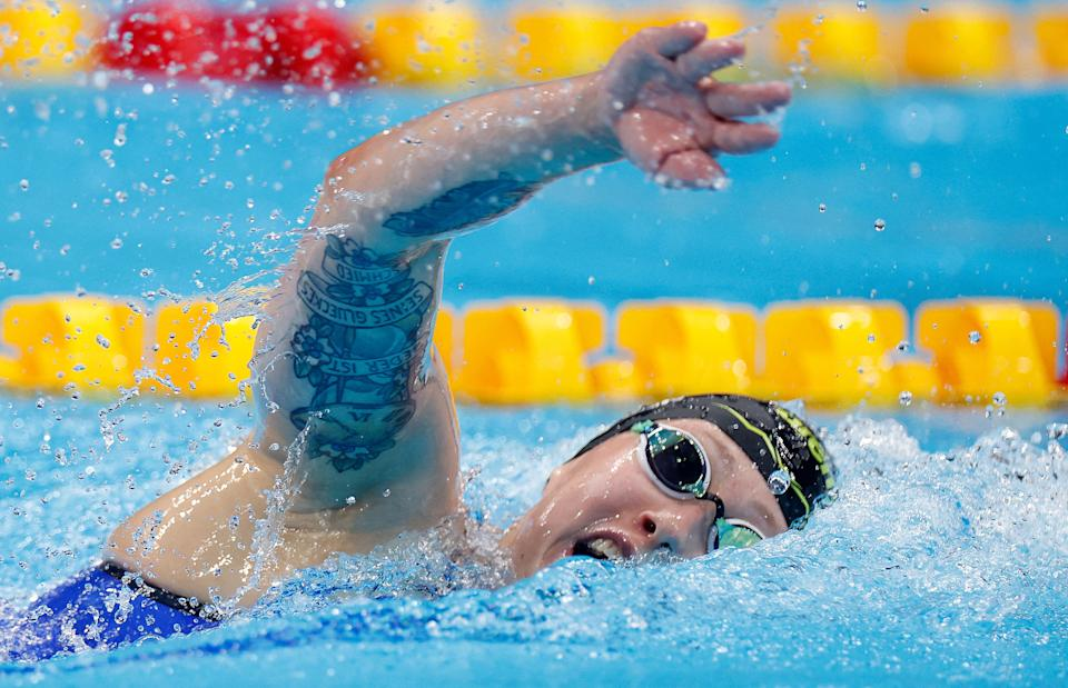 <p>Germany's Sarah Kohler competes in a heat for the women's 1500m freestyle swimming event during the Tokyo 2020 Olympic Games at the Tokyo Aquatics Centre in Tokyo on July 26, 2021. / AFP / Odd ANDERSEN</p>