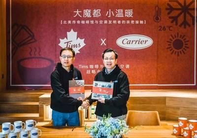 Titus Yu, managing director, Carrier Commercial HVAC Equipment, North Asia (left) and Lu Yongchen, CEO of Tim Hortons China (right) share a celebratory handshake commemorating the strategic agreement between Carrier and Tim Hortons. Through this agreement, Carrier will provide integrated HVAC solutions and services for Tims' existing and future coffee houses in China, as it plans to open more than 1,500 new stores in China in the next 10 years.
