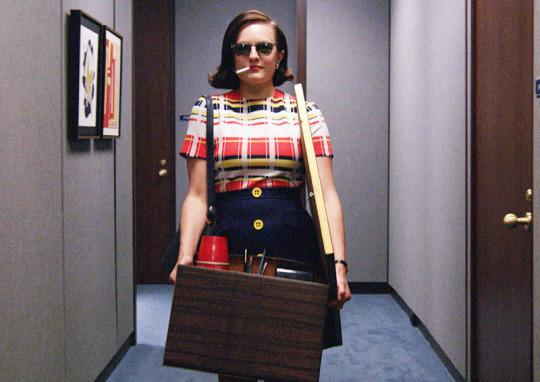 "<p>It's no shame and all game in Peggy's iconic entrance into the McCann offices, one of the coolest scenes in the entire seven seasons of <i>Mad Men</i>. Hungover, sporting shades and a cigarette dangling from her mouth, Peggy strolls into the office with a box of her personal items and Bert Cooper's framed print of <a href=""https://s-media-cache-ak0.pinimg.com/736x/58/38/49/5838493c11293747c8611b88003405b4.jpg"">The Dream of the Fisherman's Wife</a> tucked under arm, just daring anyone to think she doesn't deserve to be there. It was no surprise when <a href=""http://www.nydailynews.com/entertainment/tv/elizabeth-moss-peggy-walk-mccann-no-fun-film-article-1.2247767"">Elisabeth Moss revealed</a> the crew played ""Stayin' Alive"" to help her get into the right frame of mind to pull off the swagger: The song would have been the moment's perfect soundtrack, if not for series creator's Matt Weiner's strict rule about avoiding anachronisms. <i>— KP</i></p><p><i>(Credit: AMC)</i></p>"