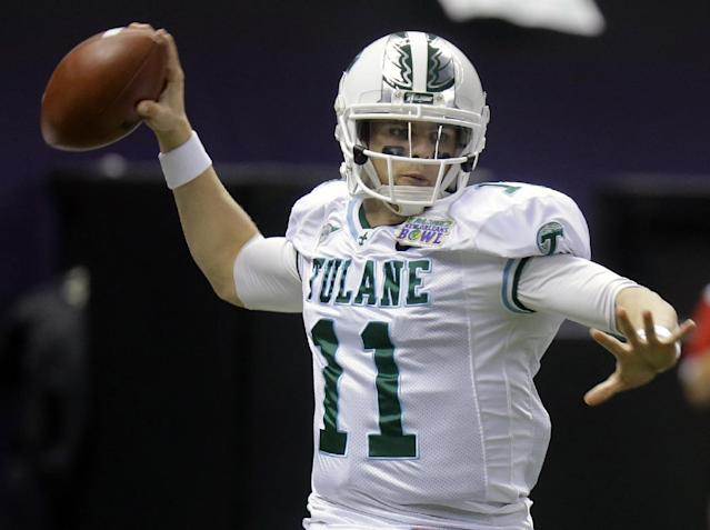 Tulane quarterback Nick Montana (11) passes against Louisiana-Lafayette during the first half of the New Orleans Bowl NCAA college football game, Saturday, Dec. 21, 2013, in New Orleans. (AP Photo/Bill Haber)