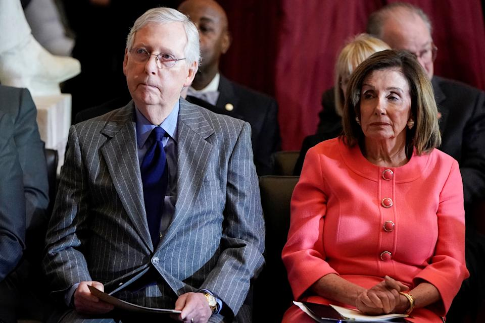 U.S. House Speaker Nancy Pelosi (D-CA) and Senate Majority Leader Mitch McConnell (R-KY) attend a Congressional Gold Medal Award ceremony for Steve Gleason at the U.S. Capitol in Washington, U.S., January 15, 2020. REUTERS/Joshua Roberts