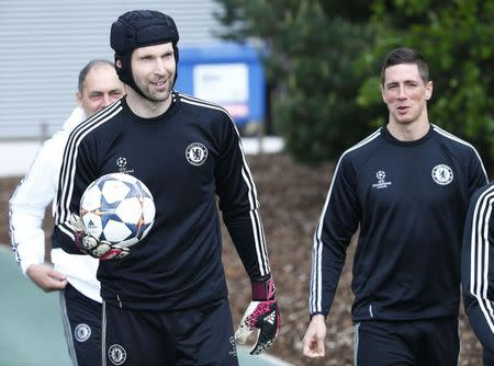 Chelsea goalkeeper Petr Cech and Fernando Torres arrive for a soccer training session at Cobham in Surrey
