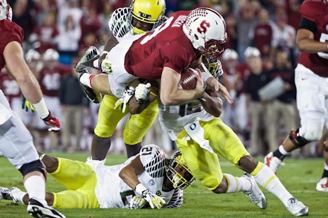 Stanford quarterback Kevin Hogan (8) scores their second touchdown in the first half of an NCAA college football game against Oregon in Stanford, Calif., Thursday, Nov. 7, 2013. (AP Photo/The Oregonian, Thomas Boyd) MAGAZINES OUT, TV OUT, LOCAL TV AND INTERNET OUT, (THE MERCURY, WILLAMETTE WEEK, PAMPLIN MEDIA GROUP OUT)