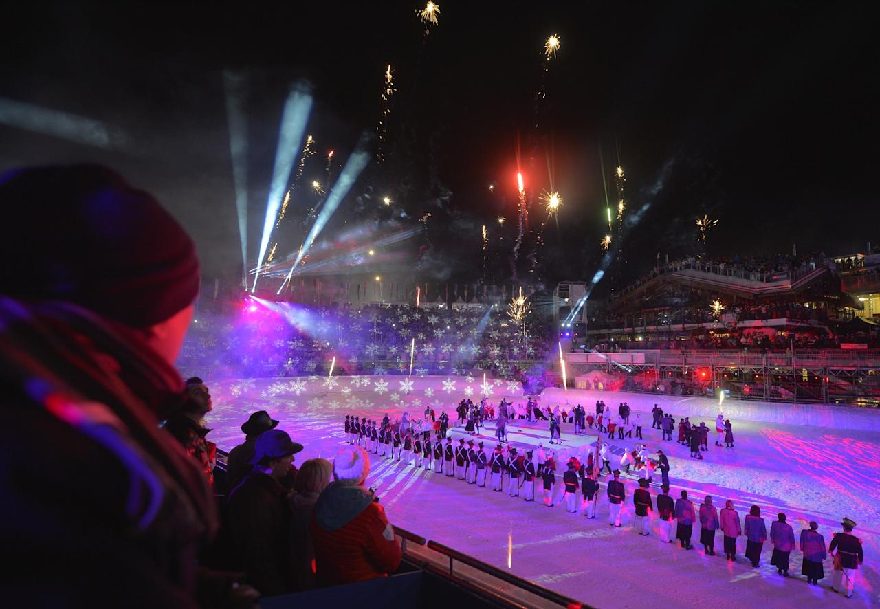 Spectators watch fireworks during the opening ceremony of the FIS World Ski Championships on February 4, 2013 in Schladming.  AFP PHOTO / FABRICE COFFRINIFABRICE COFFRINI/AFP/Getty Images