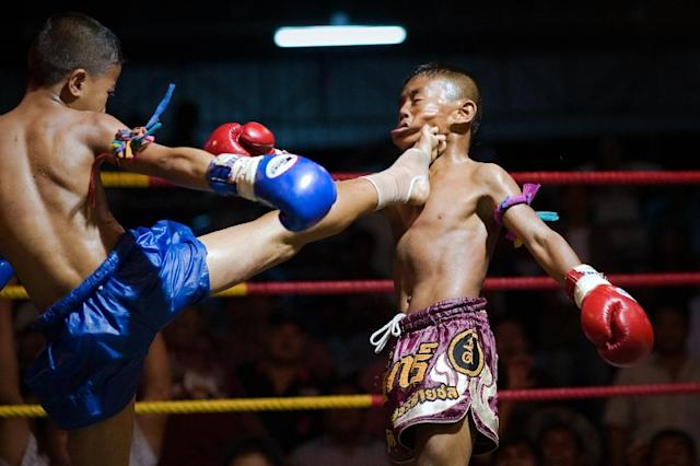 The involvement of kids in Muay Thai boxing, who sometimes start under 10 years of age, in bouts that use kicks and elbows to the head has stirred frequent criticism (AFP Photo/NICOLAS ASFOURI)