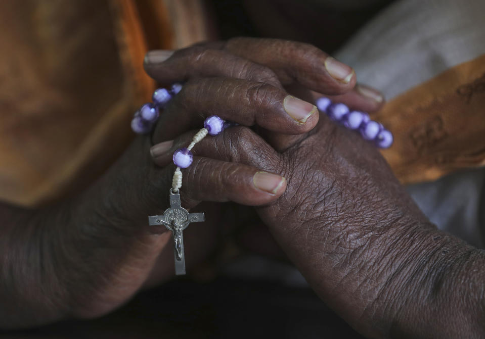An Indian Catholic Christian woman holds a rosary and prays on Ash Wednesday at Saint Mary's Basilica in Hyderabad, India, Wednesday, Feb. 26, 2020. The Ash Wednesday marks the beginning of Lent, a solemn period of 40 days of prayer and self-denial leading up to Easter.(AP Photo/Mahesh Kumar A.)