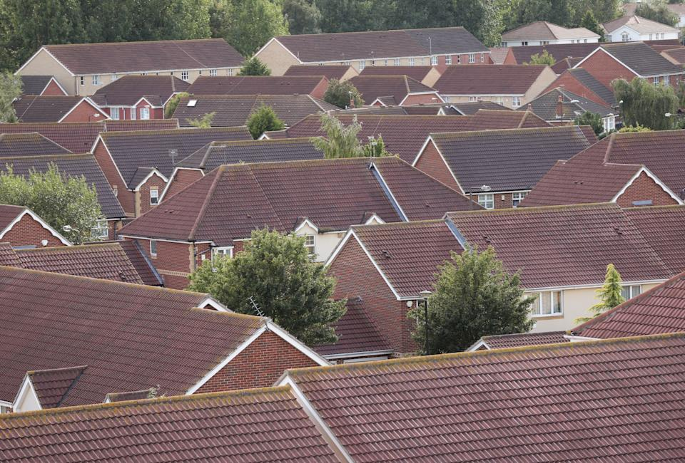Embargoed to 0001 Saturday June 15 File photo dated 19/08/14 of houses. More than one in 10 people in Britain own second homes, buy-to-let and overseas properties worth a combined �941 billion, a new study suggests.