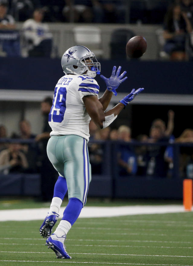 Dallas Cowboys wide receiver Amari Cooper (19) reaches up to catch a pass for a long gain agains the Philadelphia Eagles in the first half of an NFL football game in Arlington, Texas, Sunday, Oct. 20, 2019. (AP Photo/Michael Ainsworth)