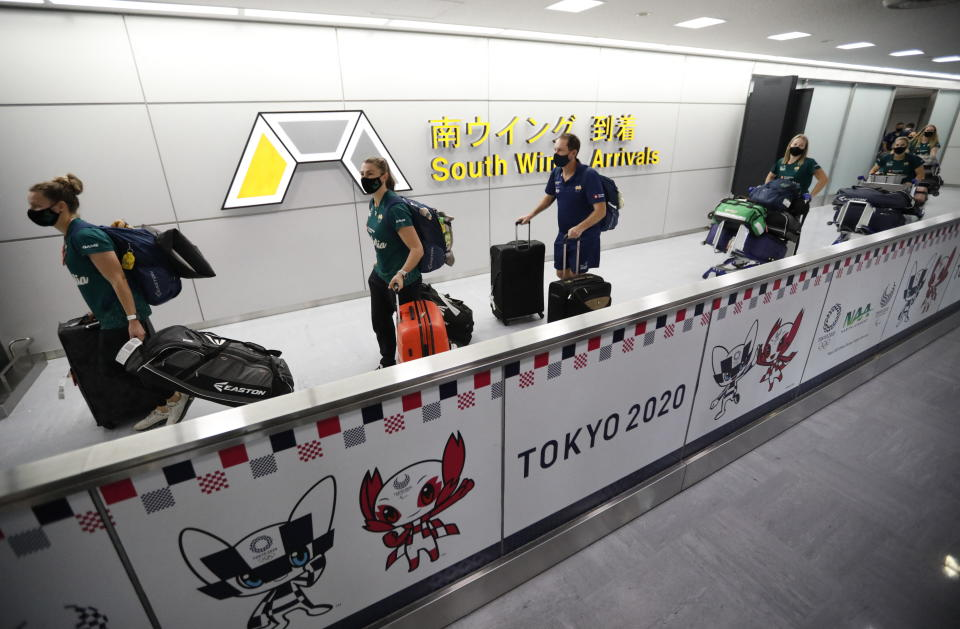Members of Australia's Olympic softball team, the first national team to come to Japan for pre-Olympic training camp since the Tokyo 2020 Olympic Games were postponed to 2021 due to COVID-19, arrive at Narita international airport in Narita, east of Tokyo, on June 1, 2021. (Photo by ISSEI KATO / POOL / AFP) (Photo by ISSEI KATO/POOL/AFP via Getty Images)