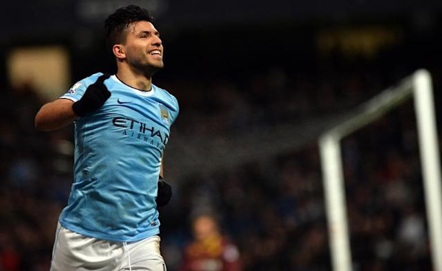 Manchester City's Argentinian striker Sergio Aguero celebrates scoring his third goal during a FA Cup match against Watford at the Etihad Stadium in Manchester on January 25, 2014