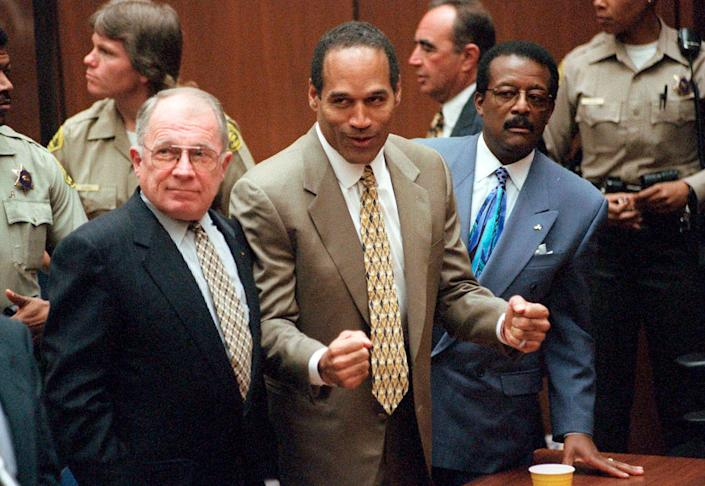 <p>FILE - In this Oct. 3, 1995, file photo, O.J. Simpson reacts as he is found not guilty in the death of his ex-wife Nicole Brown Simpson and her friend Ron Goldman in Los Angeles. Defense attorneys F. Lee Bailey, left, and Johnnie L. Cochran Jr. stand with him. Cochran, Simpson's flamboyant lead attorney, died of brain cancer in 2005 at 68. His refrain to jurors that