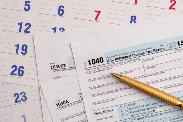 US 1040 tax form with calendar