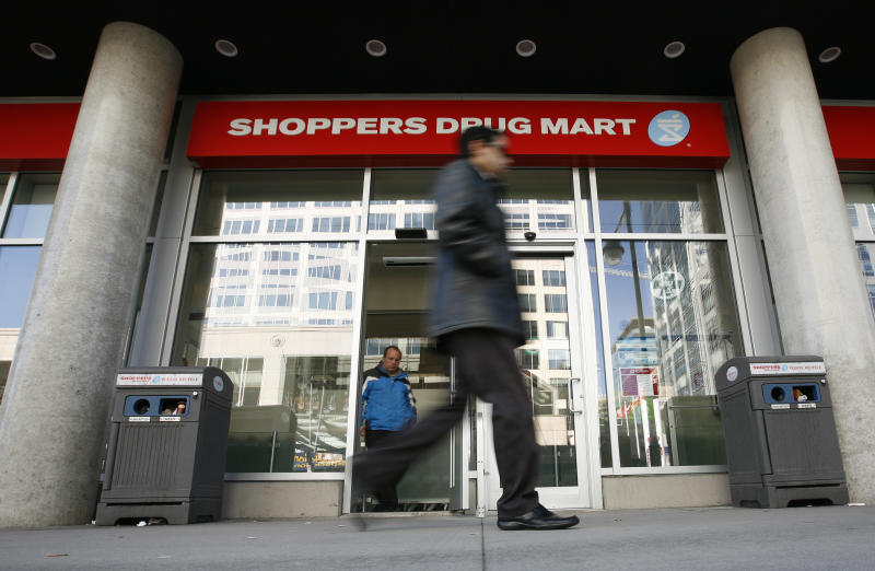 A pedestrian walks past a Shoppers Drug Mart in Ottawa November 10, 2010.