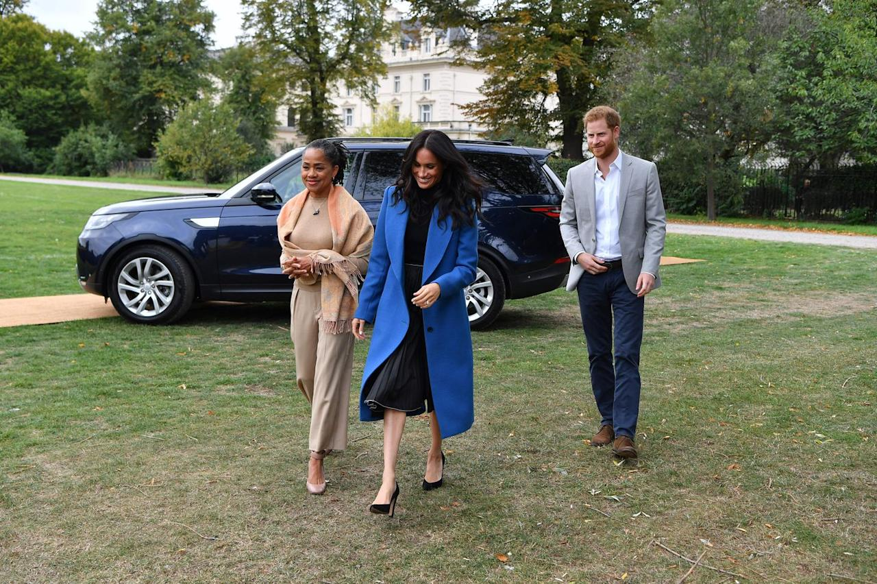 "<p>Meghan Markle arrived <a rel=""nofollow"" href=""https://www.townandcountrymag.com/society/tradition/a23334084/meghan-markle-mother-doria-ragland-cookbook-launch-appearance/"">with her mom, Doria Ragland</a>, and Prince Harry, to the launch of the <em>Together </em>cookbook <a rel=""nofollow"" href=""https://www.townandcountrymag.com/style/fashion-trends/a23322795/meghan-markle-together-cookbook-launch-outfit-blue-smythe-coat/"">wearing a blue coat by Smythe</a> with a black top, a black skirt by Misha Nonoo, and pumps <a rel=""nofollow"" href=""https://www.sarahflint.com/products/jay-pump-100-black-suede?variant=28249886273"">by Sarah Flint. </a></p>"