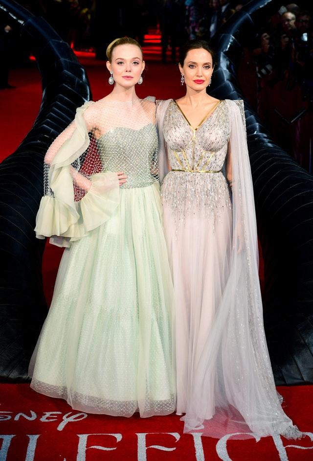 Elle Fanning (left) and Angelina Jolie