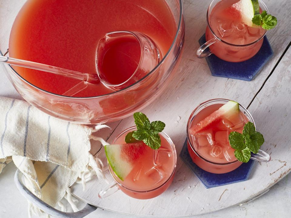 """<p><strong>Recipe: <a href=""""https://www.southernliving.com/recipes/4th-july-punch"""" rel=""""nofollow noopener"""" target=""""_blank"""" data-ylk=""""slk:4th of July Punch"""" class=""""link rapid-noclick-resp"""">4th of July Punch</a></strong></p> <p>Whether you're flying your flag lakeside, beachside, or next to the grill in your own backyard, this punch deserves a spot on your festive lineup. It's got fresh watermelon, ginger, pineapple juice, and the liquor of your choice. Plus, Topo Chico, of course! </p>"""