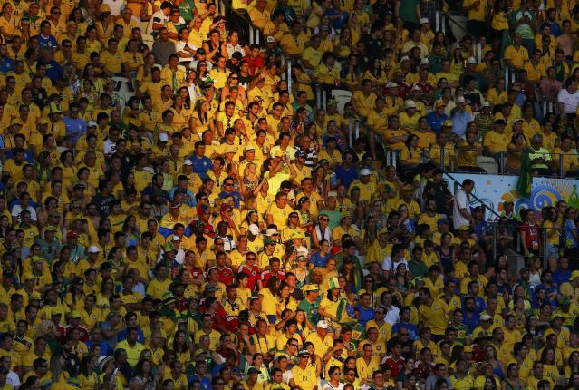 Fans watch during the 2014 World Cup quarter-finals soccer match between Brazil and Colombia at the Castelao arena in Fortaleza July 4, 2014. REUTERS/Stefano Rellandini (BRAZIL - Tags: SOCCER SPORT WORLD CUP)