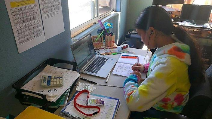 This photo provided by Charles Timtim shows his daughter, name withheld by parents, doing schoolwork from home in Waipahu, Hawaii, Tuesday, Sept. 22, 2020. (Charles Timtim via AP)