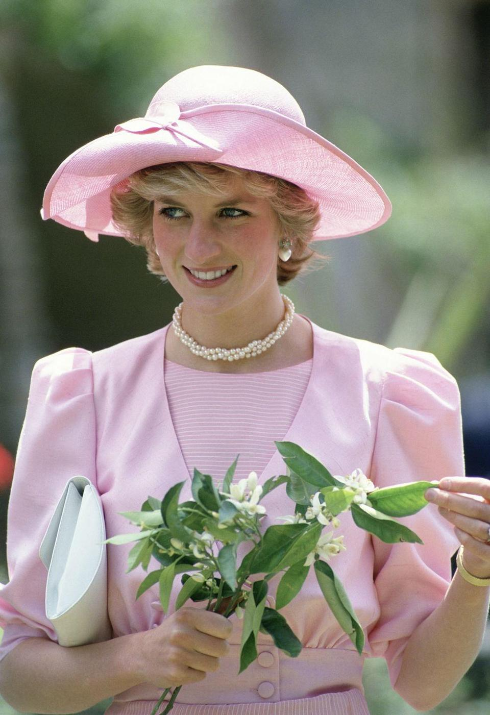 <p>On a trip to Sicily in 1985, Princess Diana looked like the proverbial English rose in a rosy suit and hat.</p>