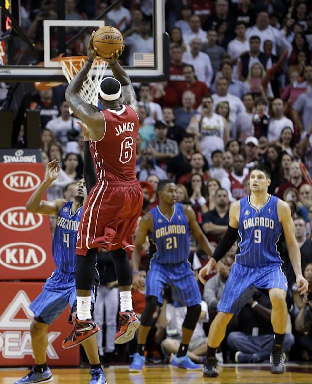 Miami Heat small forward LeBron James (6) prepares to shoot the go-ahead and eventual game-winning basket against the Orlando Magic in the final seconds of the fourth quarter of an NBA basketball game, Saturday, Nov. 23, 2013, in Miami. Miami won 101-99. (AP Photo/Alan Diaz)