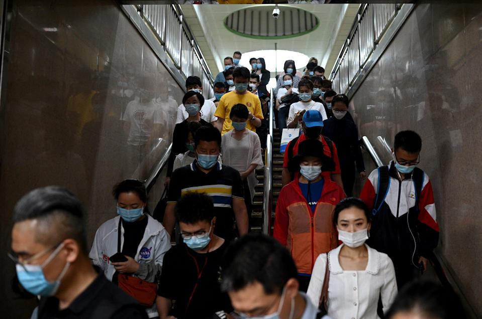 Ground down by the sapping realties of modern city life, China's youth are 'lying flat,' the latest buzzword for those tapping out of a culture of endless work with little reward (AFP via Getty Images)