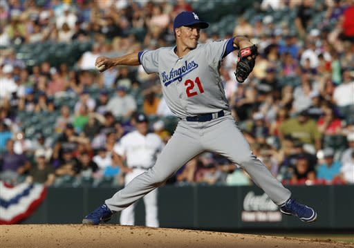Los Angeles Dodgers starting pitcher Zack Greinke works against the Colorado Rockies in the first inning of a baseball game in Denver, Wednesday, July 3, 2013. (AP Photo/David Zalubowski)