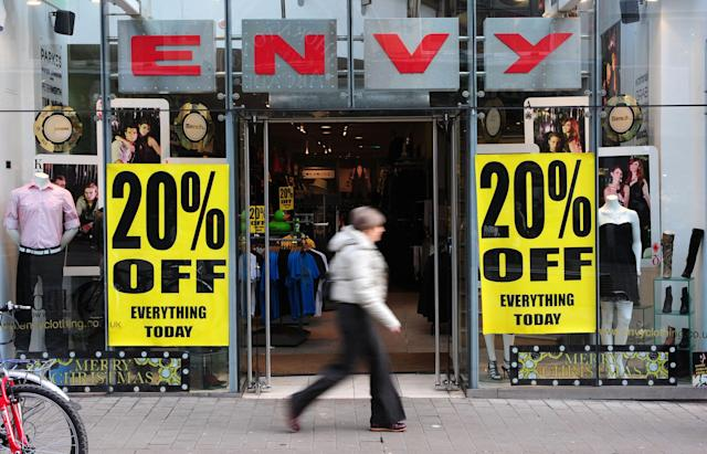Shops advertising sales in Leeds city centre, England. Photo: PA