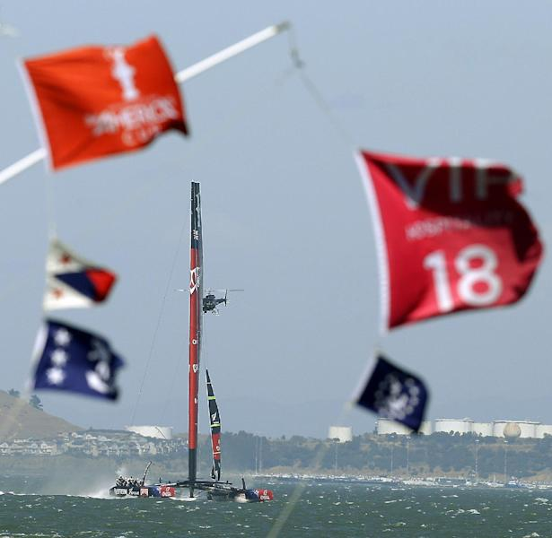 Emirates Team New Zealand sails in to base Tuesday, Sept. 17, 2013, in San Francisco. Tuesday's races have been postponed because of high winds blowing against a strong tide sweeping out of San Francisco Bay. (AP Photo/Ben Margot)