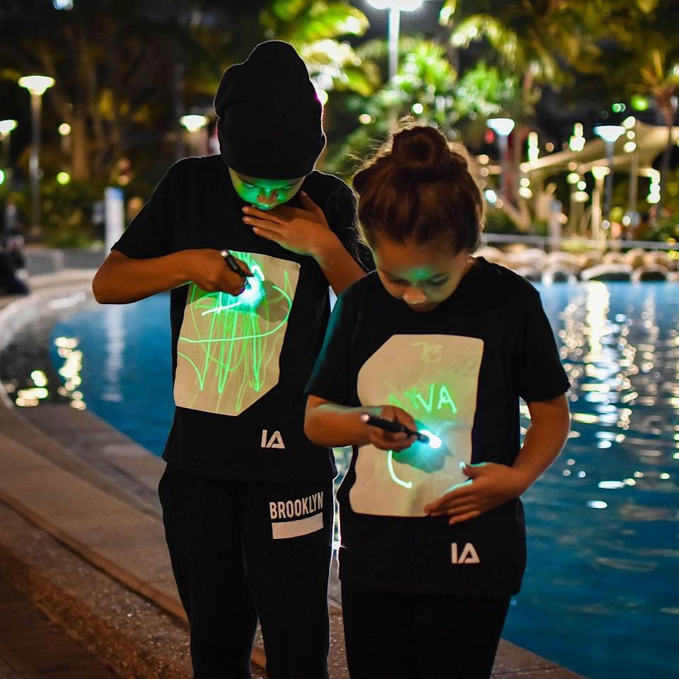 """<p>Get them this <a href=""""https://www.popsugar.com/buy/Light-Up-Drawing-Tee-588051?p_name=Light%20Up%20Drawing%20Tee&retailer=uncommongoods.com&pid=588051&price=25&evar1=moms%3Aus&evar9=32519221&evar98=https%3A%2F%2Fwww.popsugar.com%2Ffamily%2Fphoto-gallery%2F32519221%2Fimage%2F47606748%2FLight-Up-Drawing-Tee&list1=gifts%2Choliday%2Cgift%20guide%2Cgifts%20for%20kids%2Ckid%20shopping%2Ctweens%20and%20teens%2Cgifts%20for%20teens&prop13=api&pdata=1"""" class=""""link rapid-noclick-resp"""" rel=""""nofollow noopener"""" target=""""_blank"""" data-ylk=""""slk:Light Up Drawing Tee"""">Light Up Drawing Tee</a> ($25) in their size.</p>"""