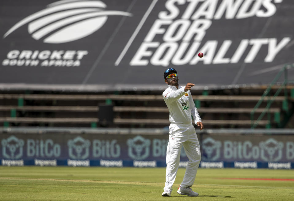 Sri Lanka's captain Dimuth Karunaratne throws the ball during the 2nd Test cricket match between South Africa and Sri Lanka Wanderers stadium in Johannesburg, South Africa, Sunday, Jan. 3, 2021. (AP Photo/Themba Hadebe)