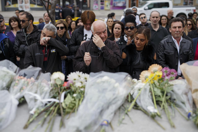 <p>People gather for a moment of silence at a memorial for victims of the mass killing on Yonge St. at Finch Ave. on April 24, 2018 in Toronto, Canada. (Photo: Cole Burston/Getty Images) </p>