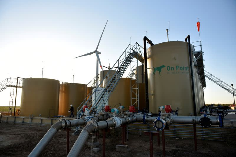 FILE PHOTO: A wastewater injection facility operated by On Point Energy is seen at sunrise in Big Spring