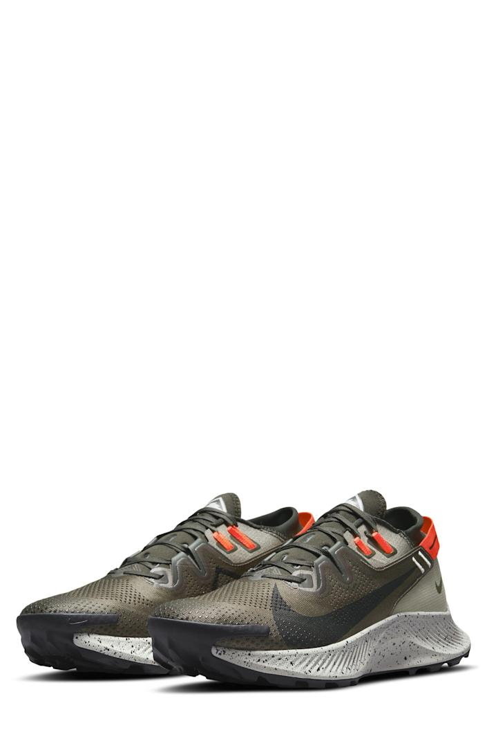 """<p><strong>Nike</strong></p><p>nordstrom.com</p><p><strong>$94.90</strong></p><p><a href=""""https://go.redirectingat.com?id=74968X1596630&url=https%3A%2F%2Fwww.nordstrom.com%2Fs%2Fnike-pegasus-trail-2-trail-running-shoe-men%2F5756811&sref=https%3A%2F%2Fwww.bestproducts.com%2Ffitness%2Fg37158206%2Fnordstroms-anniversary-sale-best-sneakers%2F"""" rel=""""nofollow noopener"""" target=""""_blank"""" data-ylk=""""slk:BUY IT HERE"""" class=""""link rapid-noclick-resp"""">BUY IT HERE</a></p><p><del>$130</del><strong><br>$95</strong></p><p>In the mood for some trail running while you're away on your <a href=""""https://www.menshealth.com/technology-gear/g36954813/mens-health-outdoor-awards-2021/"""" rel=""""nofollow noopener"""" target=""""_blank"""" data-ylk=""""slk:camping trip"""" class=""""link rapid-noclick-resp"""">camping trip</a>? We thought you might be. Pack these into your duffel and you'll be good to go.</p>"""