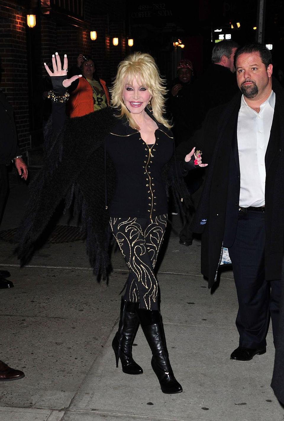 <p>We don't see Dolly wearing this color often, but when she does, she makes sure to do so with her bedazzled flair. A fringe jacket, gold jewelry, and black pants with gold designs ensure she is as glitzy as ever—even in black. </p>