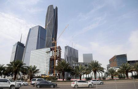 FILE PHOTO: Cars drive past the King Abdullah Financial District, north of Riyadh