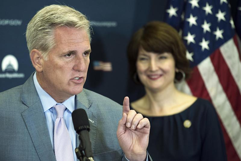 Majority Leader Kevin McCarthy speaks with reporters, as Representative Cathy McMorris-Rodgers looks on: AP