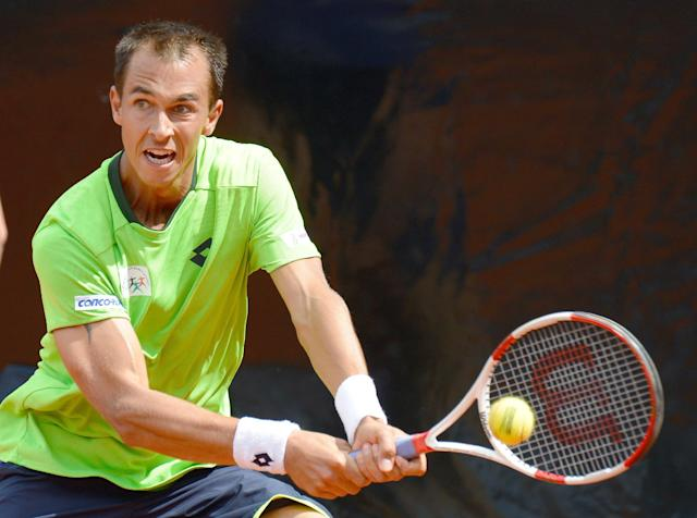 Czech Republic's Lukas Rosol returns a ball to Roberto Bautista Agut from Spain, during the final match of the Mercedes Cup ATP tennis tournament in Stuttgart, Germany, Sunday July 13, 2014. (AP Photo/dpa, Daniel Maurer)