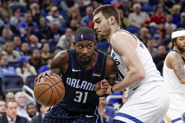 Orlando Magic guard Terrence Ross (31) drives around Minnesota Timberwolves forward Juan Hernangomez during the second half of an NBA basketball game Friday, Feb. 28, 2020, in Orlando, Fla. (AP Photo/John Raoux)