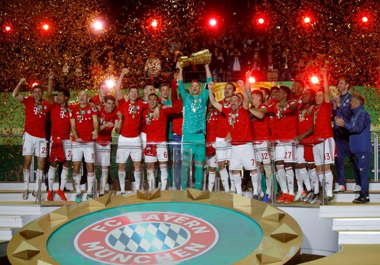Bayern Munich players celebrate with the trophy after the German Cup Final