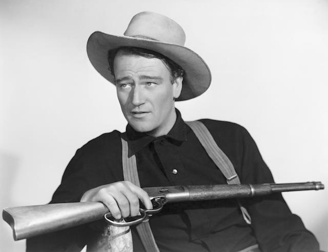 An airport named for John Wayne (pictured in the film <em>Shepherd of the Hills</em>) is under pressure to distance itself from the classic film star over his racist statements. (Photo: Getty Images)