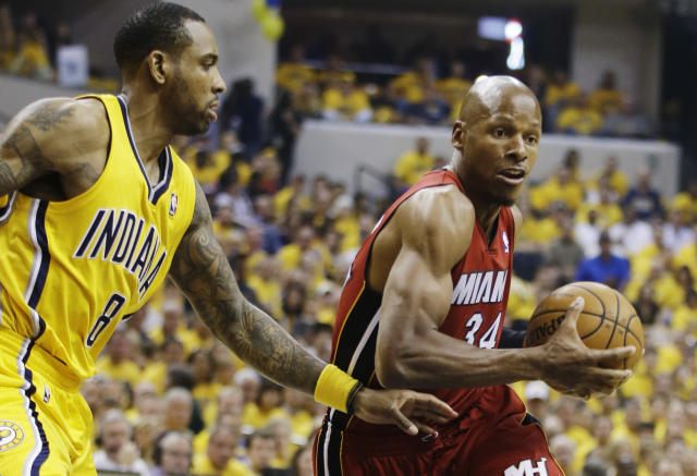 Miami Heat guard Ray Allen (34) drives around Indiana Pacers guard Rasual Butler (8) during the first half of Game 1 of the Eastern Conference finals NBA basketball playoff series Sunday, May 18, 2014, in Indianapolis. (AP Photo/Darron Cummings)