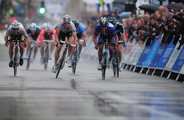 LONDON, ENGLAND - SEPTEMBER 18: Mark Cavendish of Team HTC Highroad beats team mate Mark Renshaw to the line to win Stage Eight of the Tour of Britain at Whitehall, London on September 18, 2011 in London, England. (Photo by Jamie McDonald/Getty Images)
