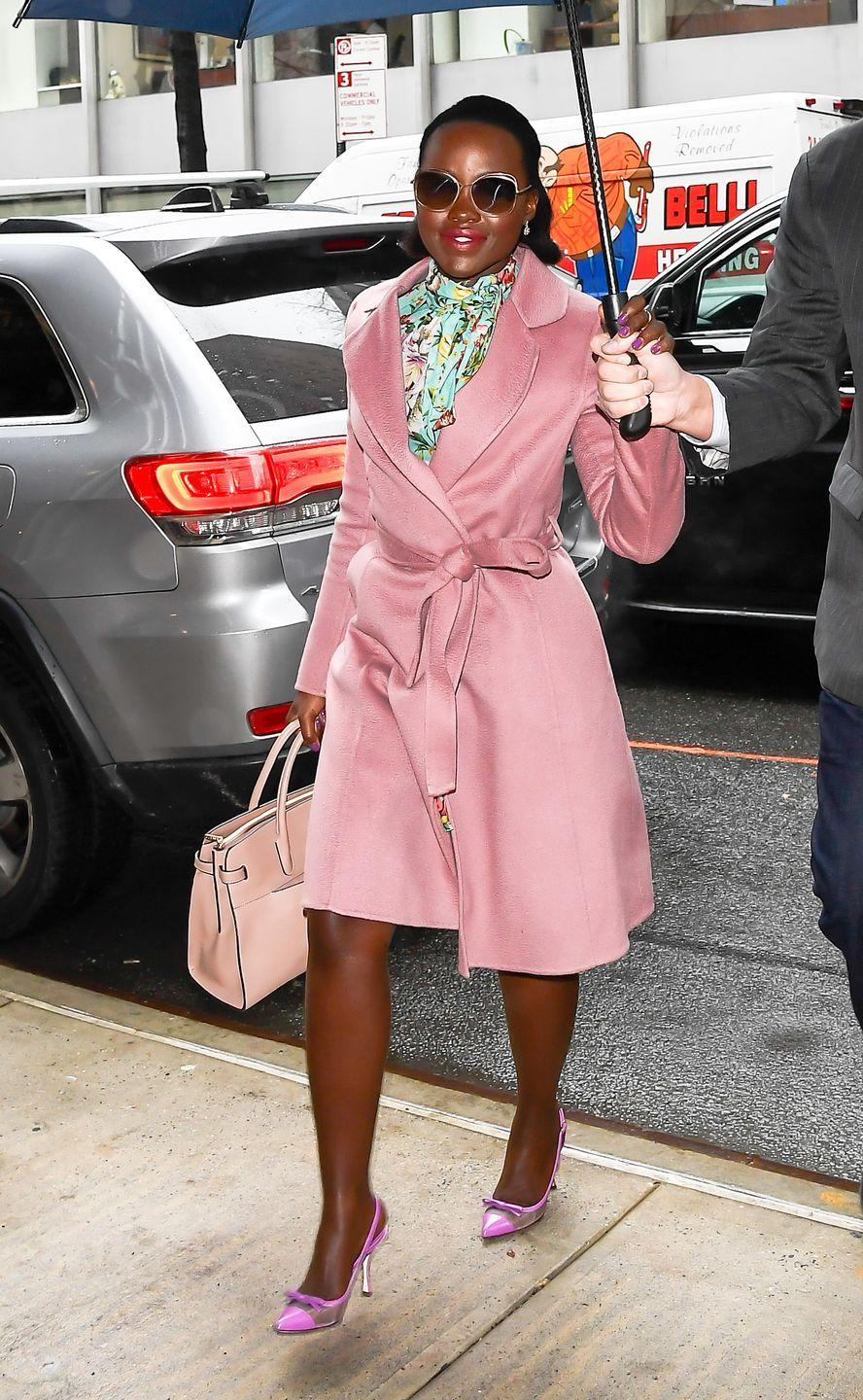 <p>Attending an event in New York in a bright floral Dolce & Gabbana dress, paired with a powder-pink coat and matching accessories. </p>