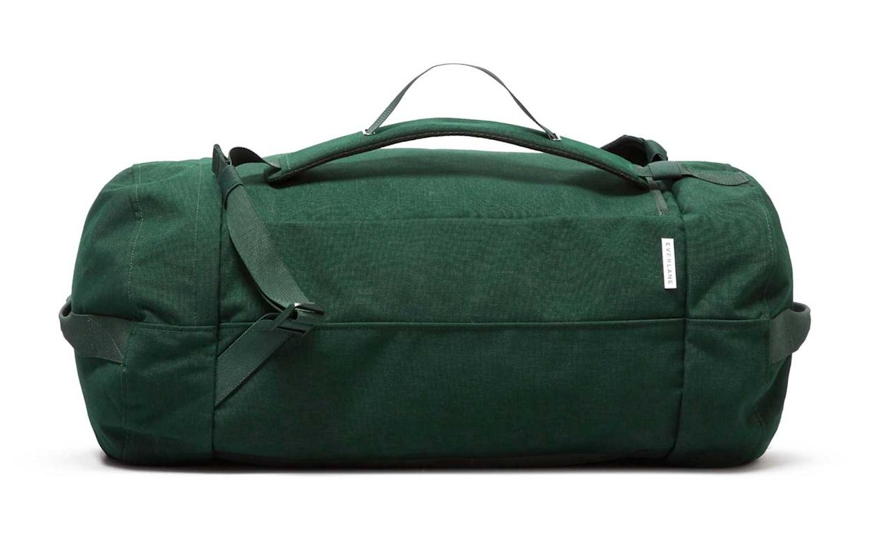 """<p>This duffel/backpack has top and bottom haul handles, ventilated mesh shoulder straps, and in-strap handles so you can carry it three different ways. It also features a separate shoe compartment and a convenient wide U-zip opening.</p> <p>To buy: <a href=""""https://www.pjatr.com/t/8-9711-131940-104709?sid=TL%2C15ConvertibleBagsThatDoDouble%2528andTriple%2529Duty%2Cdibeneds%2CTRA%2CGAL%2C721726%2C201910%2CI&url=https%3A%2F%2Fwww.everlane.com%2Fproducts%2Fwomens-nylon-duffel-pack-darkgreen"""" target=""""_blank"""">everlane.com</a>, $78</p>"""