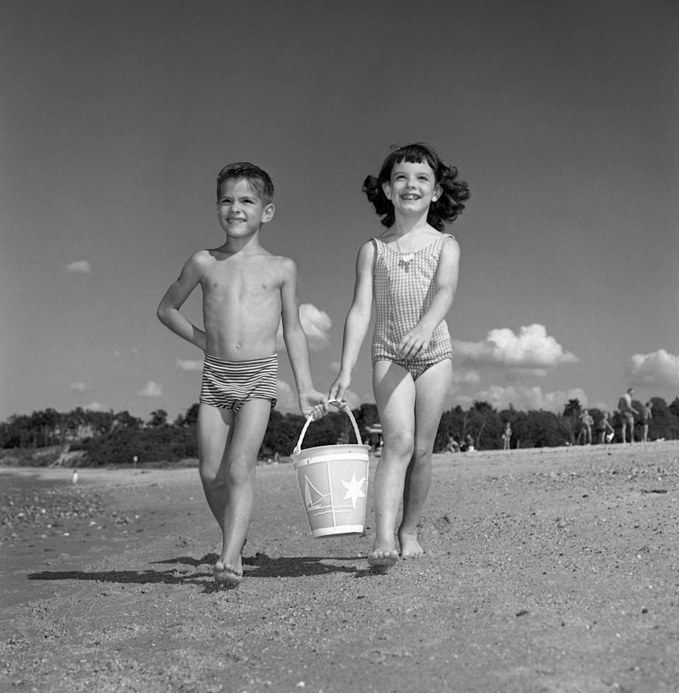 """<p>The '60s were all about teens having fun in beach movies. The whole family would go to the ocean together. Kids were water babies. As your parents were setting up beach umbrella and chairs, you would immediately beg to go to the water. And they let you, with the command, """"stay where I can see you."""" But really, the lifeguards were like babysitters.<br></p>"""