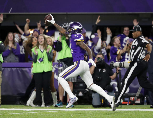 Vikings WR Stefon Diggs celebrates his 61-yard game-winning touchdown against the Saints in the playoffs. (AP)