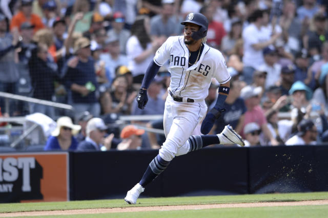 San Diego Padres' Fernando Tatis Jr. rounds third base on a RBI double hit by Francisco Mejia during the fifth inning of a baseball game against the Arizona Diamondbacks Wednesday, April 3, 2019, in San Diego. (AP Photo/Orlando Ramirez)