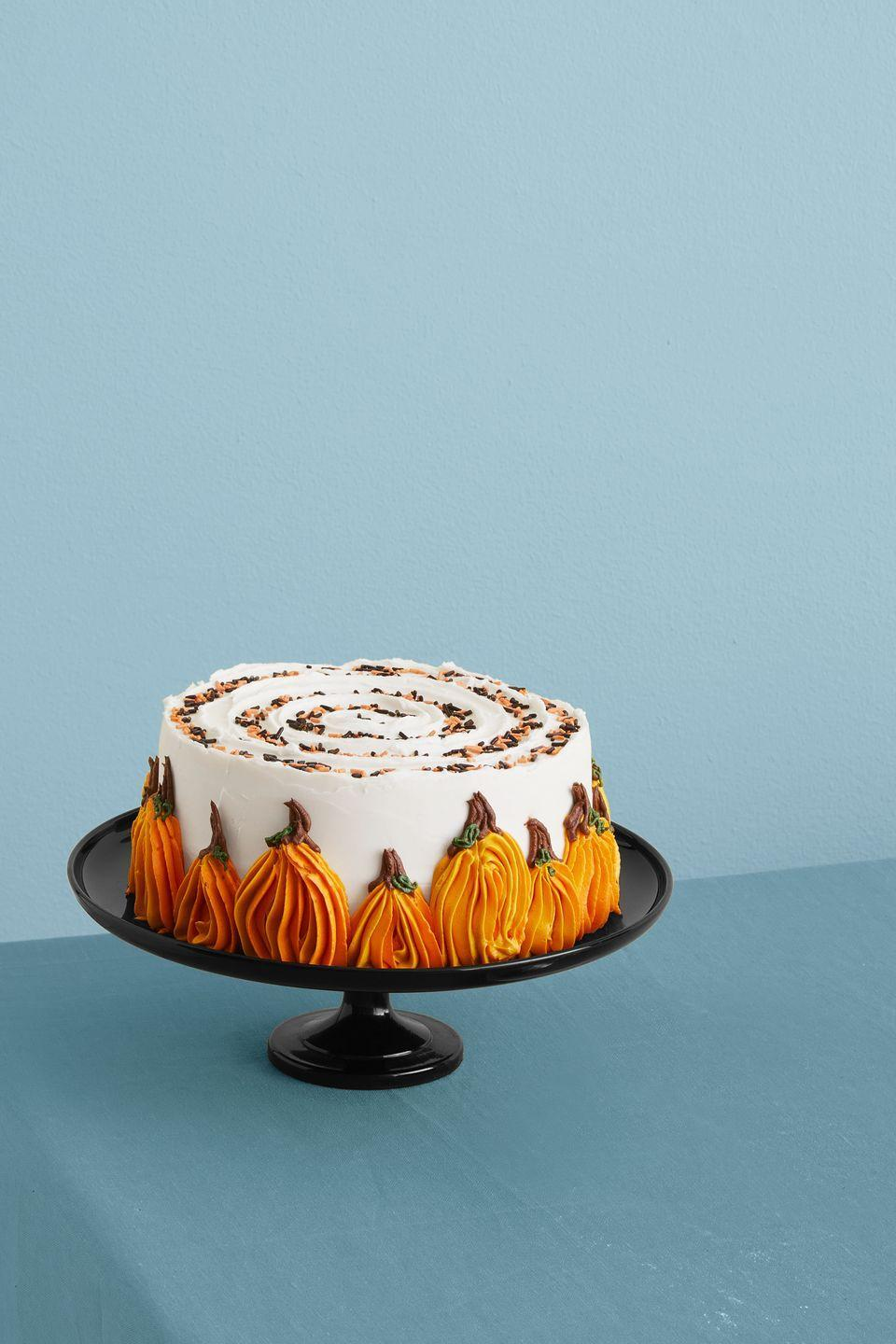 """<p>If you have a knack for decoration, then you'll love tackling the icing pumpkins on this fall-flavored cake.</p><p><strong><em><a href=""""https://www.womansday.com/food-recipes/a33564114/pumpkin-chocolate-chip-cake-recioe/"""" rel=""""nofollow noopener"""" target=""""_blank"""" data-ylk=""""slk:Get the Pumpkin Chocolate Chip Cake recipe."""" class=""""link rapid-noclick-resp"""">Get the Pumpkin Chocolate Chip Cake recipe.</a></em></strong></p>"""