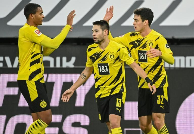 Dortmund's US midfielder Giovanni Reyna (R) celebrates scoring the-equaliser at Frankfurt in mid December