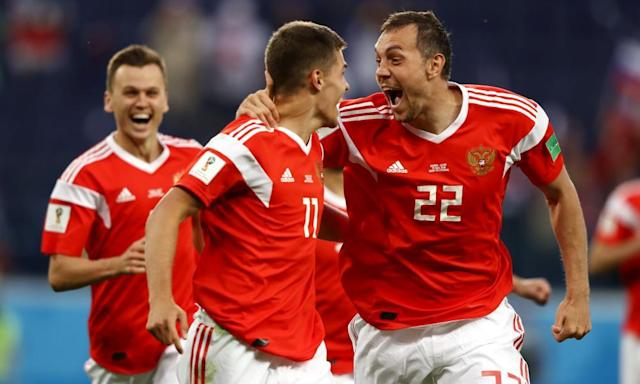 <span>Russia, who have won their first two World Cup matches, celebrate their opening goal against Egypt. </span> <span>Photograph: Jamie Squire - FIFA/Getty Images</span>